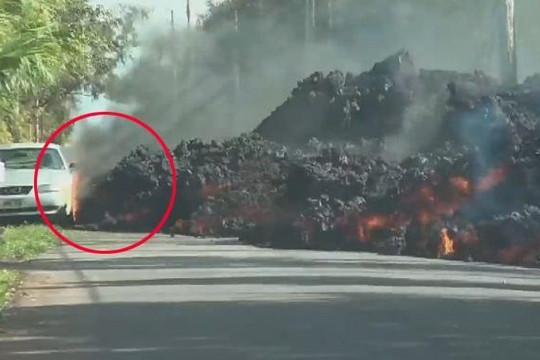 Cận cảnh dung nham núi lửa tràn ra đường, nung chảy xe hơi ở Hawaii