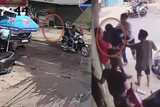 Clip bắn ná bể kính xế hộp ở TP.HCM, 2 thanh niên bị húc văng xe máy, đánh nhừ tử