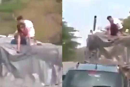 Clip cặp đôi làm chuyện ấy trên nóc xe tải đang chạy: Đứt dây thần kinh xấu hổ!