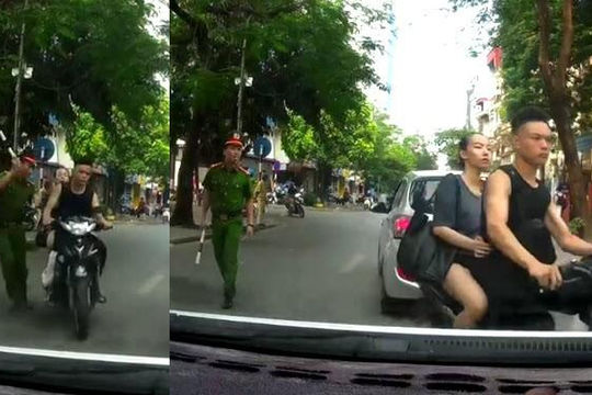Clip cặp đôi không mũ bảo hiểm suýt ăn gậy vì tăng tốc, vượt mặt công an Hà Nội