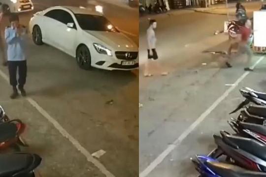 Bị nhắc vì đỗ ô tô trước cửa hàng, tài xế sang chảnh gọi bạn tới đánh anh bảo vệ