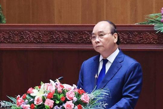 Chủ tịch nước Nguyễn Xuân Phúc: Người Việt Nam coi nhân dân Lào là anh em một nhà